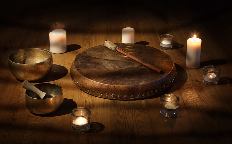 Drum, singing bowls, and candles
